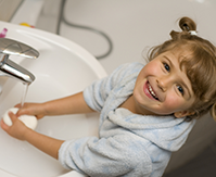 Image of child with eczema washing hands